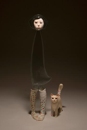 Yu Jinyoung, I'm OK 3, 2009. PVC, mixed media, h: Human 127 cm, Cat 37 cm. Courtesy Galleria Patricia Armocida, Milano