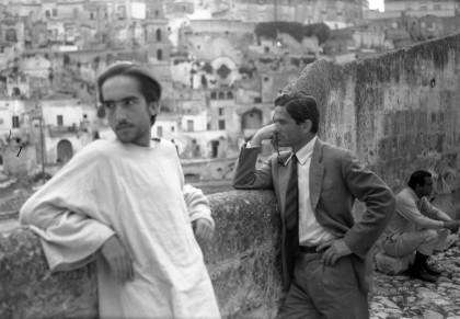 """Pier Paolo Pasolini and Enrique Irazoqui during a break on the set of """"Il Vangelo secondo Matteo"""", in front of Sassi di Matera panorama, June 1964  @ Associazione Pasolini Matera, photo Archivio Notarangelo"""