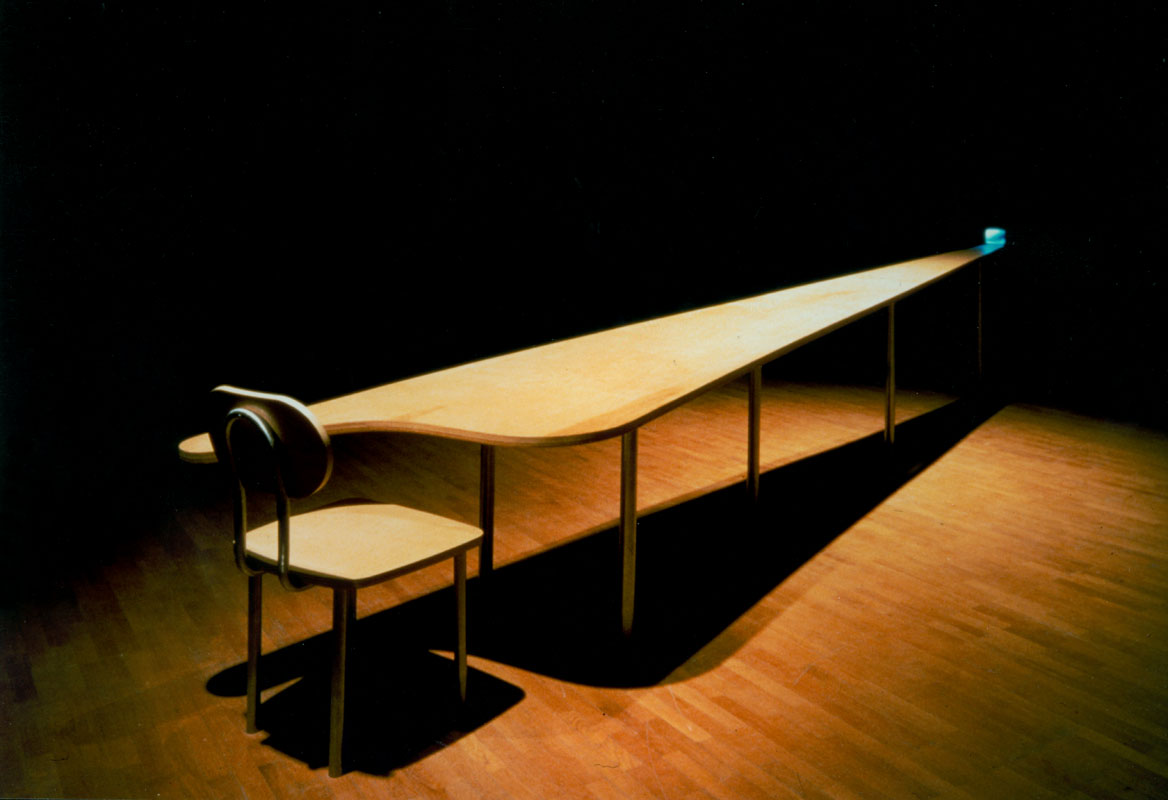 GARY HILL Learning Curve (Still point), 1993 Single channel video installation. Silent. One five inch color monitor. Plywood chair/table construction Lunghezza Tavolo 560 cm. Edition of 2
