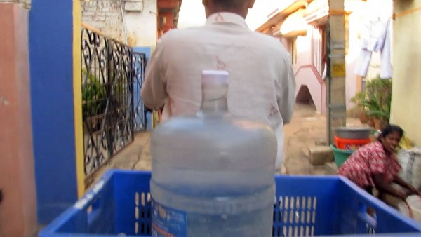 Labour in a Single Shot. A project by Antje Ehmann and Harun Farocki. Watercan Delivery, Bangalore 2012. Filmstill  © Nikhil Patil, Arav Narang