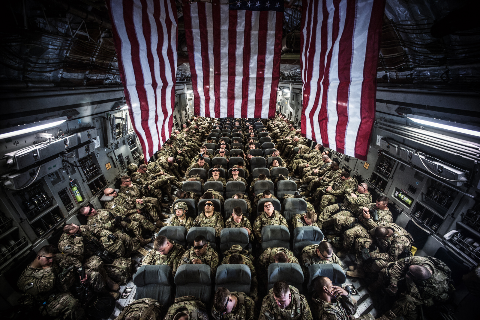 © Ryan Spencer Reed, Soldiers of the 1-506th Infantry Regiment, 4th Brigade Combat Team, 101st Airborne Division, (the battalion known as the Band of Brothers) are enroute on a C-17 from Transit Center at Manas Kyrgyzstan to Bagram Air Field. Taken: 2013.05.05